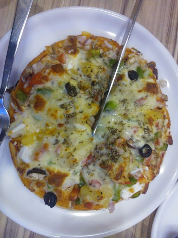 Italian Punjabi style : pizza with pineapple, pyaz and yes paneer...