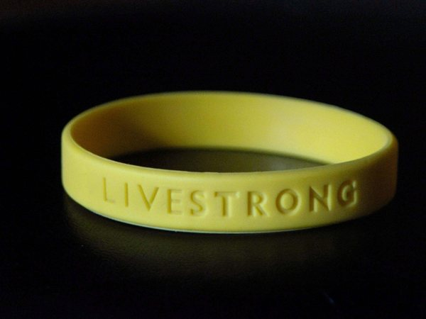 Yellow 'livestrong' wristband of the Lance Armstrong Foundation