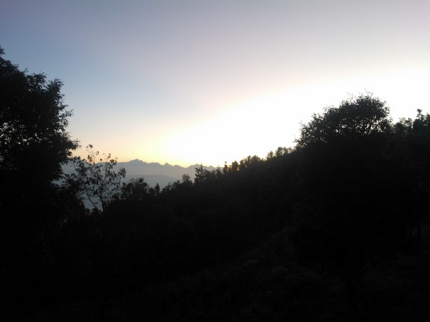 Sun already risen but hidden among the  Pine and Oak tree forests at the Himalayan hills, Jhaltola, Pithoragarh, Uttarakhand