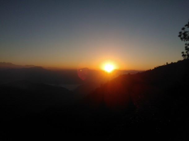 Sun peaking through the Himalayan mountain range, Jhaltola, Pithoragarh, Uttarakhand