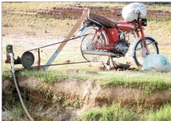 Motorcycle powered irrigation