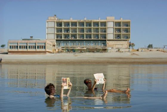 December 1964, Dead Sea : Bathers read magazines near shoreline while floating in the Dead Sea