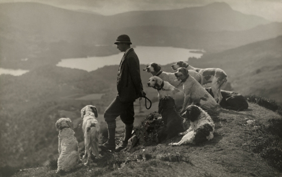 March 1919, Scotland : Dogs help a Scottish gamekeeper keep watch in Aberfoyle