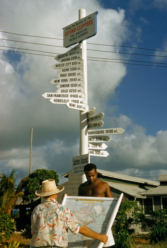 January 1955 : Signpost on Kanton Island lists mileage to cities served by Pan American World Airways.