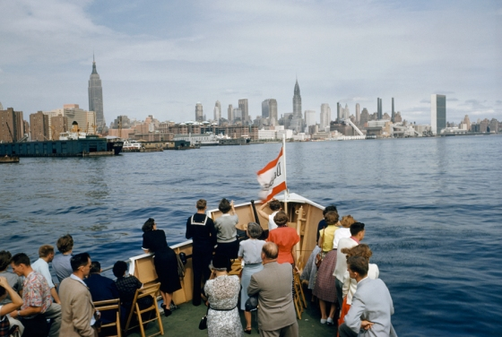 December 1954, USA : Tourists look at Manhattan from a sightseeing boat on the East River