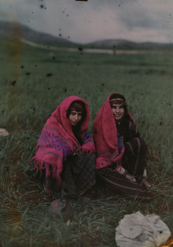 1926 Palestine : Two girls wearing shawls pose for a portrait in Huwara, Palestine