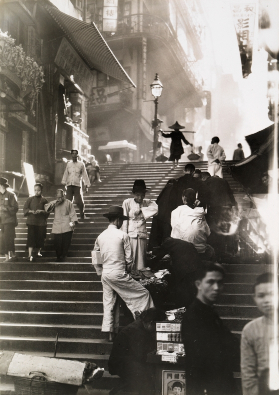 November 1934 Hong Kong : Vendors and pedestrians along a steep staircase in Hong Kong