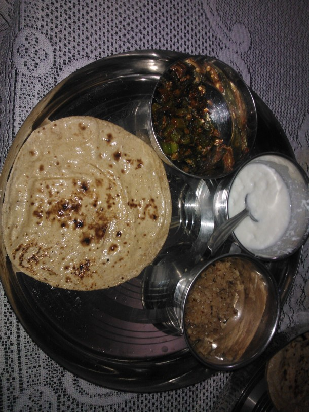 Taste of India - wonderful culture of hospitality in Rajasthan : Roti (indian bread), stir-fried spicy Okra, home made curd and Churma (coarsely ground wheat crushed and cooked with ghee and sugar)
