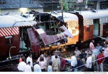 2006 Mumbai train bombings - Series of coordinated bomb attacks strikes several commuter trains in Mumbai, India during evening rush hour