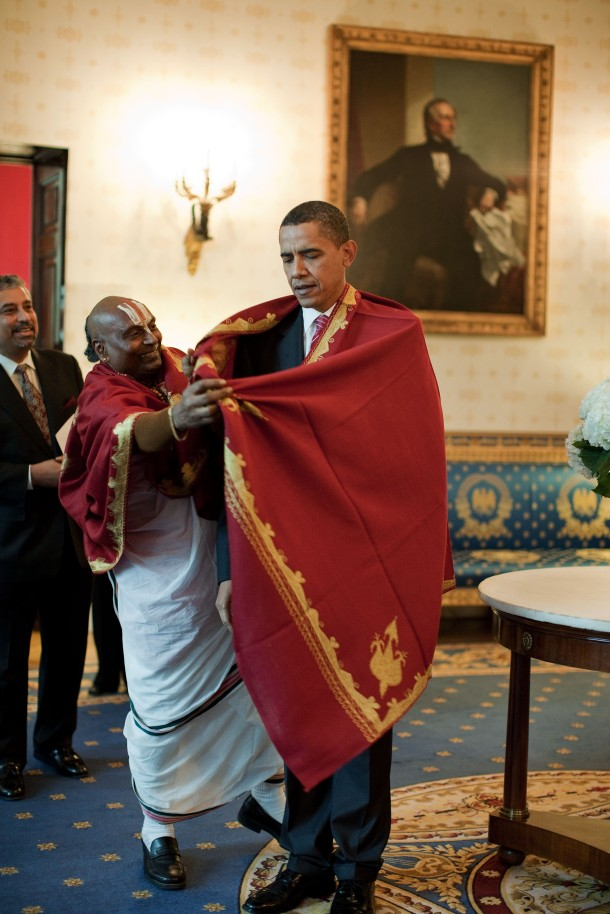 President Barack Obama receiving a shawl from a Hindu Priest