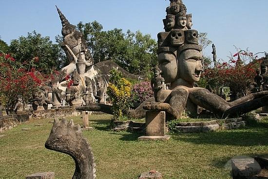 Reclining Buddha and Brahma - Hindu Buddhism, Park Laos, Vietnam