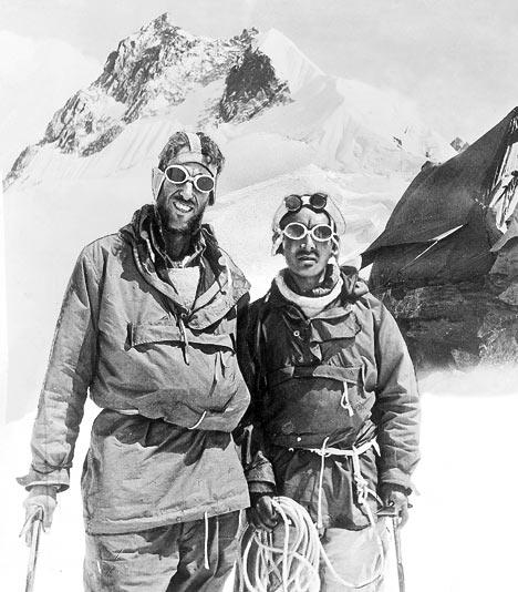 Edmund Hillary of New Zealand and Sherpa Tenzing Norgay of India returning from mainden Everest summit